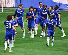 players of chelsea celebrating a goal in semi final match against tottenham hotspur
