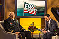 "Chief of Staff of the U.S. Army Gen. Raymond T. Odierno, left, speaks with ""Fox and Friends"" co-host Brian Kilmeade before going live on the set Dec. 11, 2013, in New York 131211-A-KH856-012.jpg"