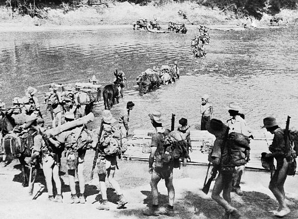 A Chindit column crosses a river in Burma; men suffering from dysentery often went naked. - Chindits