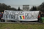 Demonstrators in Chișinău, Moldova, holding a banner