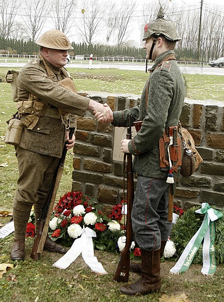 Re-enactors Peter Knight and Stefan Langheinrich, descendants of Great War veterans, shake hands at the 2008 unveiling of a memorial to the 1914 Christmas Truce.