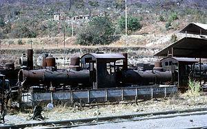 South African Class NG9 4-6-0 - CF Moçâmedes no. 111 (right) and possibly no. 113 (left), at the Sa da Bandeira shops, Angola, 7 August 1972
