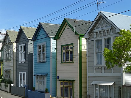 A row of classic weatherboard houses in the Mount Victoria neighbourhood Classic weatherboards in Wellington, NZ.jpg
