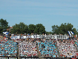 Montreal Impact (1992–2011) - A card display mosaic tifo celebrating the UM02's 5th anniversary at Montreal's Claude-Robillard Centre.