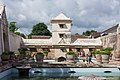 Concubine bathing area and tower, filled with people, Taman Sari, Yogyakarta 2014-04-24.jpg