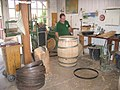 Constructing an oak wine barrel at French cooperage.jpg