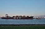 Container ship being towed in the Scheldt towards the Port of Antwerp, seen from Doel, Belgium (DSCF3880).jpg