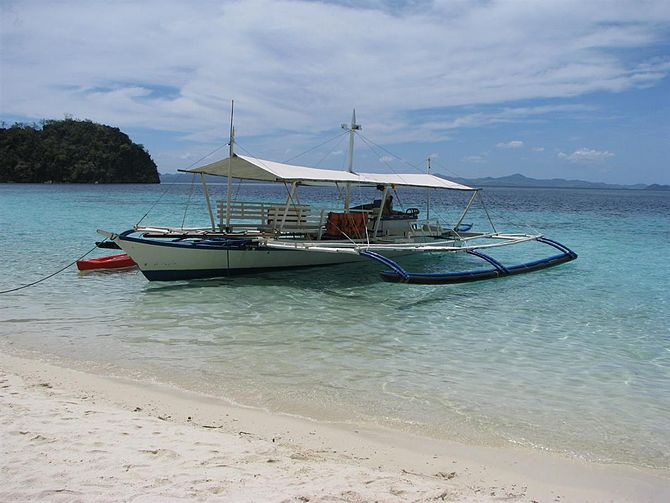 Traditional Philippine boats commonly called b...