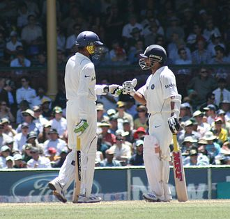 Partnership (cricket) - Harbhajan Singh and Sachin Tendulkar support each other mid-innings.
