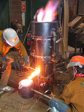 Cupola furnace - A small cupola furnace in operation at Wayne State University, in Detroit, Michigan.