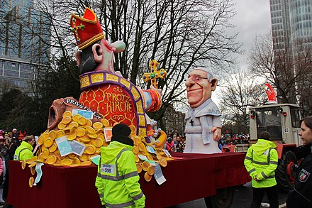 A Carnival float of Pope Francis and Germany's prelate Franz-Peter Tebartz-van Elst, Dusseldorf, 2014 Dusseldorf Rosenmontag 2014 IMG 1350 (12915484354).jpg