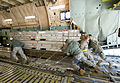 Defense.gov News Photo 110325-F-IV526-115 - Airmen load cargo onto a C-5M Super Galaxy aircraft at Dover Air Force Base Del. on March 25 2011. The cargo is bound for Italy in support of.jpg