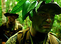 Defense.gov News Photo 110612-M-EV637-052 - U.S. Marine Sgt. Kairo Ortez right and Navy Petty Officer 3rd Class Marcus Green patrol the jungle in the Eram Sisik training area as part of.jpg