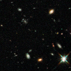 Early galaxies in Hubble Ultra Deep Field 2009 (WFC3-IR, close-up 1).jpg