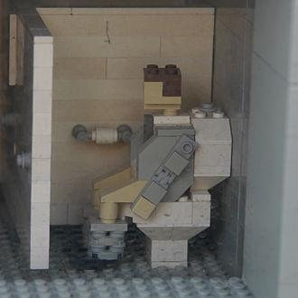 Legoland California - A Lego man using the toilet in Legoland California's Grand Central Station model.
