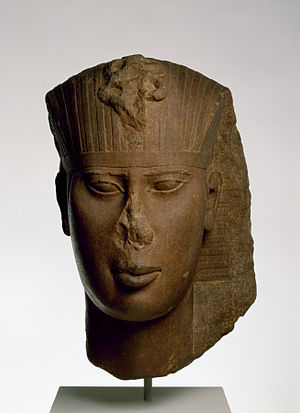 Amasis II - This head probably came from a temple statue of Amasis II. He wears the traditional royal nemes head cloth, with a protective uraeus serpent at the brow. Circa 560 BCE. Walters Art Museum, Baltimore.