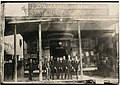 Employees posing outside Lowman & Hanford Co building on First and Cherry, Seattle, 1882 (MOHAI 8766).jpg