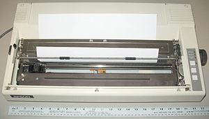"Dot matrix printing - This is an example of a wide-carriage printer, designed for paper 14 inches wide, shown with legal paper loaded (8.5""×14""). Wide carriage printers were often used by businesses, to print accounting records on 11""×14"" tractor-feed paper. They were also called 132-column printers, though this description was only true for a specific font size and type that was built into the printer's electronics"