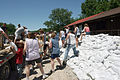 FEMA - 35671 - Residents place sand bags to form an embankment in Iowa.jpg