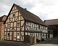 Fachwerkwohnhaus des 18. Jh. einer Hofanlage - Früher Karl Bold Lebensmittel - Meinhard-Grebendorf Kirchstraße 27 - panoramio.jpg