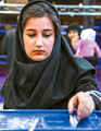 February 26 2016-Iranian legislative election-a voter casts her ballot in a box at a polling station in Nishapur.png