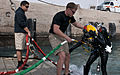 Female diver leaves her mark in history 130221-A-KU062-265.jpg