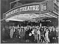 "First-nighters posing for the camera outside the Warners' Theater before the premiere of ""Don Juan"" with John Barrymore, - NARA - 535750.jpg"