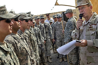 Purple Heart - Admiral Mike Mullen reads the citations for seven soldiers receiving Purple Hearts for wounds sustained in Afghanistan