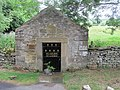 Front and entrance of holy well well house, near Wolsingham, Co. Durham.jpg