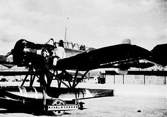 Attack on Sydney Harbour - Nobuo Fujita with a plane of the type he flew over Sydney on 17 February 1942. The seaplanes aboard I-29 and I-21 were of the same type.