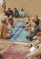 GIs and Afghans relaxing at Kandahar Air Field.jpg