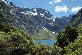 Glimpse of Lake Marian in front of Mt Crosscut.jpg