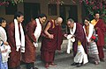Greeting His Holiness the Great 14th Dalai Lama at his residence in Dharamsala, India His Holiness Dagchen Rinpoche with his family, wife, two of his sons, Ani and Zaya, and Adrienne Chan, monk, on Pilgrimmage in 1993 (3948862040).jpg