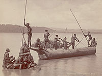 Group of Andamanese people hunting turtles with bows and arrows.