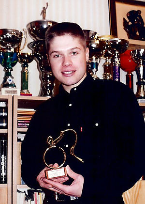 Grzegorz Gwiazdowski - Grzegorz Gwiazdowski presenting the trophy for the Polish cyclist of the year 1999 at his home in Kurzętnik, Poland