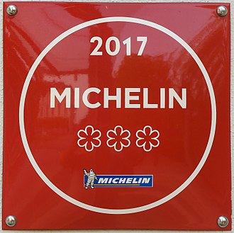Restaurant rating - Michelin three stars, at the entrance of a restaurant
