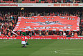 Gunnersaurus and the Arsenal Flag (6270058833).jpg