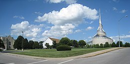 Road junction with grassy lawn and three churches
