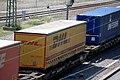 Heidelberg - Sattelauflieger DHL auf Güterwagen.JPG