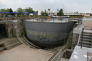 form of lock gate consisting of a large floating iron or steel box