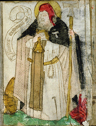 Tau Cross - Saint Anthony of Egypt wearing the Antonine cloak in a 1460s woodcut