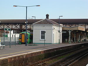 Hove railway station - The island platform looking east, with the long footbridge behind.  Southern EMU 377436 stands at Platform 1 with a London Victoria service.