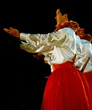 Dancer with pūʻili (Hula ʻauana), Merrie Monarch Festival