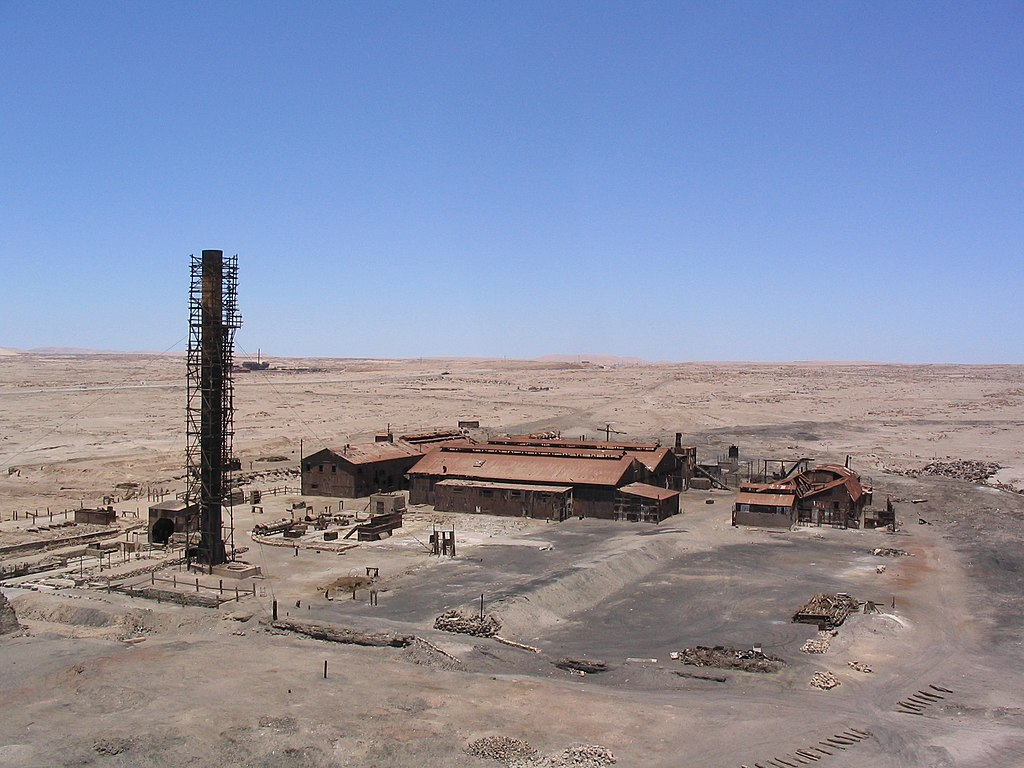 Old factory buildings in the abandoned city of Humberstone, Chile