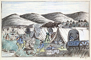 Donner Party - An encampment of tents and covered wagons on the Humboldt River in Nevada, 1859