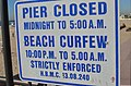 Huntington Beach and Pier official hours sign - panoramio.jpg