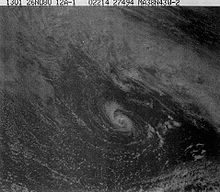 A satellite photo showing a small hurricane, there are a lot of clouds surrounding it