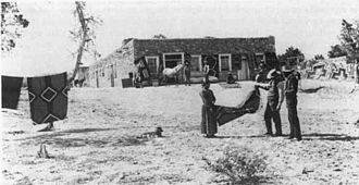 Ganado, Arizona - Hubbell and a weaver in front of the post in the 1890s