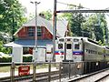 Inbound train stopping at Wallingford PA station.jpg