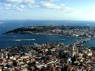 Golden Horn - An aerial view of Galata (foreground), the Historic Peninsula (background), and the new Galata Bridge, which straddles the Golden Horn and, connects its two shores at the point where it meets the Bosphorus (off the picture, left) and the Sea of Marmara (behind the Historic Peninsula). Seraglio Point is located at the eastern tip of the Historic Peninsula (center, left). The Princes' Islands are along the horizon, at upper left.